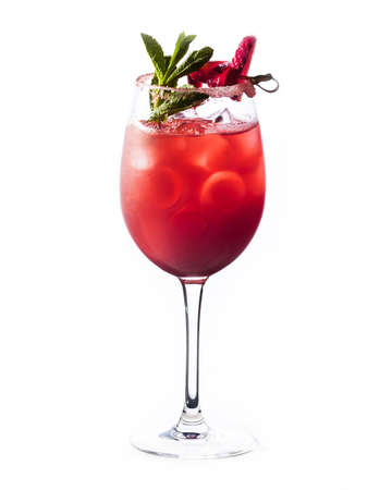 Strawberry cocktail in a glass with ice and mint isolated.