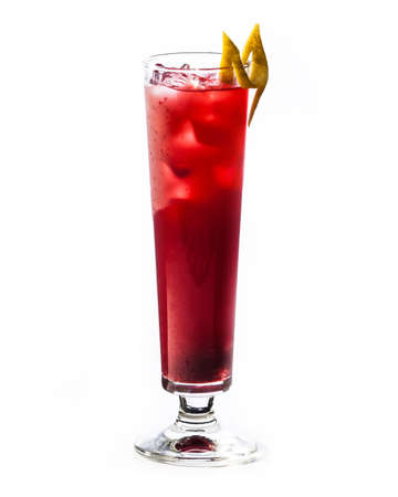 A glass of red cocktail drink with ice isolated on white background.