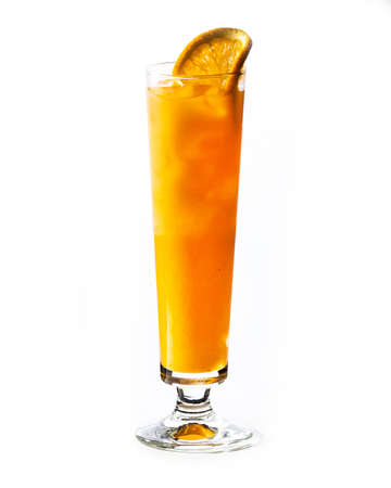 Cocktail with orange juice and ice cubes on white background. Foto de archivo