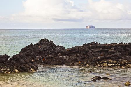 santa s helper: Bachas Beach has beautiful corners of sand and volcanic rock Where many tourists arrive, Santa Cruz Island, Galapagos