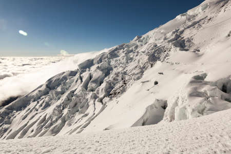 cracks in ice: Walls of ice and cracks on the glacier of Cotopaxi volcano, Andes, Ecuador Stock Photo