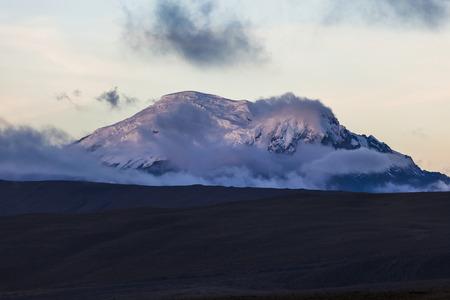 dim light: Antisana volcano lit by a dim light at sunset, Ecuador