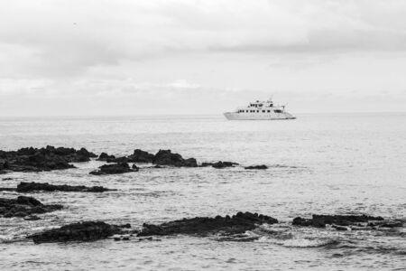 bn: Bachas Beach has beautiful corners of sand and volcanic rock where many tourists arrive, Santa Cruz Island, Galapagos