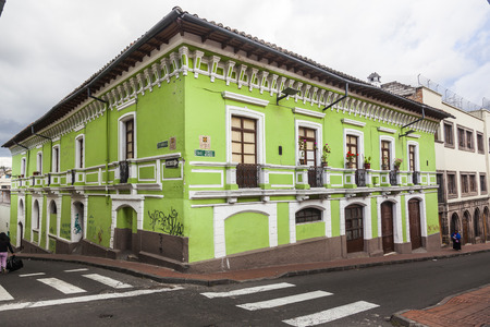 corner of house: Painted green corner house in the old Quito, Ecuador