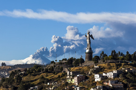 Cotopaxi volcano eruption and Panecillos Madona seen from Quito, Ecuador Фото со стока