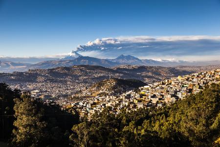 QUITO, ECUADOR -AUGUST 22, 2015: Cotopaxi Volcano eruption for several days, as seen from Quito in Ecuador, Southamerica.