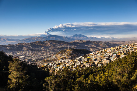 QUITO, ECUADOR -AUGUST 22, 2015: Cotopaxi Volcano eruption for several days, as seen from Quito in Ecuador, Southamerica.