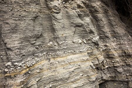 in layers: Geological layers exposed by erosion