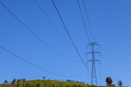 postes: High tension cables and transmission towers Stock Photo
