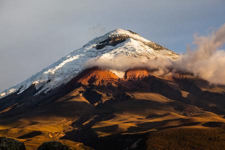 setting  sun: Cotopaxi volcano illuminated by the last rays of setting sun Stock Photo