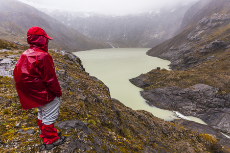 Climber with red sweater Yellow lagoon in the crater of El Altar