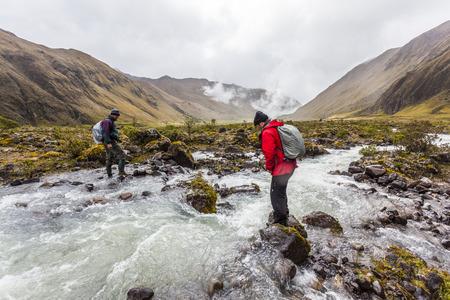 Collanes, ECUADOR MARCH 08: Climbers crossing the river on the moors Collanes volcano Altar on March 8, 2015, Vallle Collanes, Ecuador