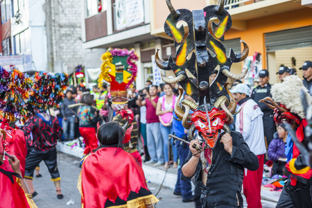 6 people: Pillaro, Ecuador - january 6: People disguised as devils dancing on streets of Pillaro, Ecuador Diablada de Pillaro celebration january 3, 2016 in pillaro, Ecuador