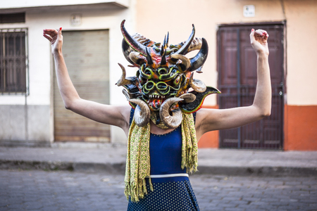 festivities: Píllaro, ECUADOR - FEBRUARY 6, 2016: Unidentified woman, dressed as Devil in the diabladas festivities in Pillaro.