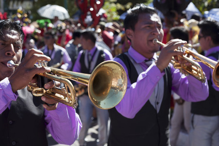 Píllaro, ECUADOR - FEBRUARY 6, 2016: Bands encourage and accompany the groups on the feast of the diabladas of Pillaro Éditoriale