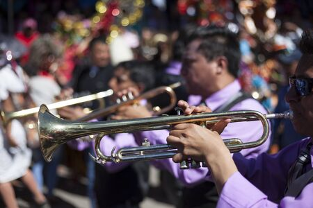 lucifer: P�llaro, ECUADOR - FEBRUARY 6, 2016: Bands encourage and accompany the groups on the feast of the diabladas of Pillaro