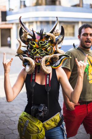 festivities: Píllaro, ECUADOR - FEBRUARY 6, 2016: Unidentified woman, dressed as Devil in the diabladas festivities in Pillaro, January 6, 2016.
