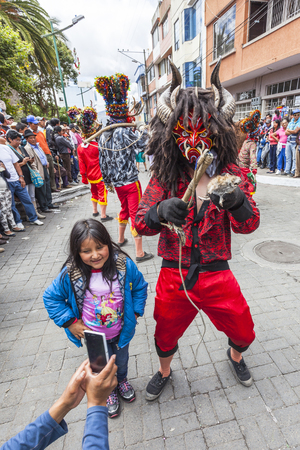 Píllaro, ECUADOR - FEBRUARY 6, 2016: Unknown locals dressed up participating in the Diablada, popular town celebrations with people dressed as devils dancing in the streets