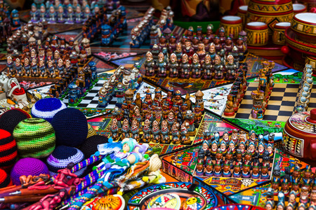 spaniards: Chess games made with figures representing Spaniards and Indians, in the Indian market of Otavalo