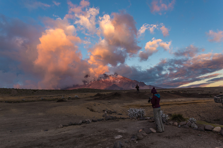 Reddish and purple clouds with blue sky at sunset over the Chimborazo volcano Stock Photo
