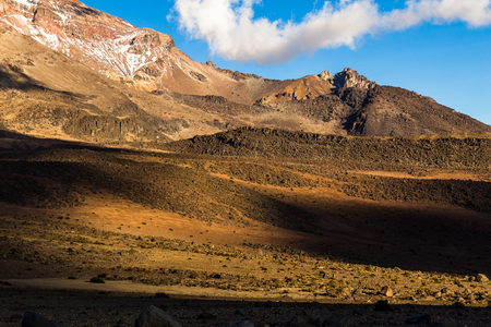 Rocky and desert slopes at sunset on the slopes of Chimborazo volcano Stock Photo