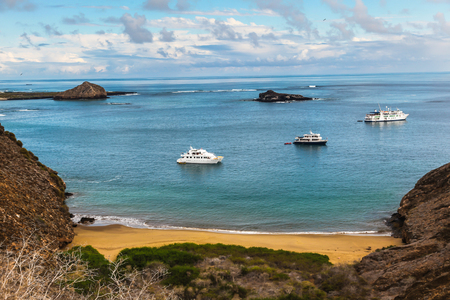 Some boats in the bay seen from the top of Punta Pitt, Galapagos Stock Photo