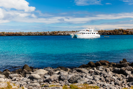 White boat anchored in the bay of Isla Plaza Sur, Galapagos