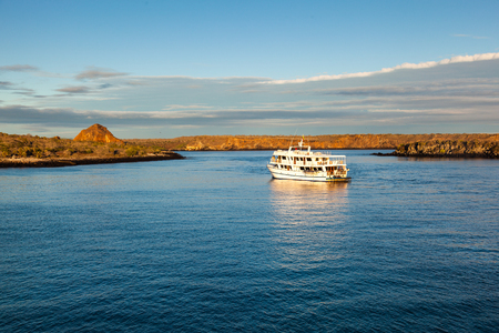 Cruise approaching Isla Plaza Sur, Galapagos on a warm morning