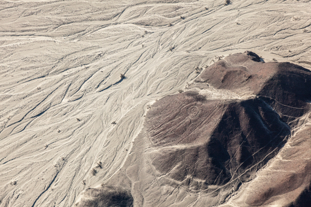 Aerial view of the relief of the desert and the lines of Nazca, the astronaut, Peru Stock Photo