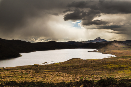 Dramatic sunset on La Mica lagoon, strong contrasts and bright clouds Banco de Imagens