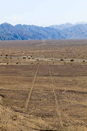 Nazca Lines, you can see at ground level as it extends to the horizon a perfect straight line