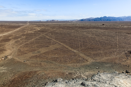 From a hill you can see some straight lines of nazca that extend to the horizon