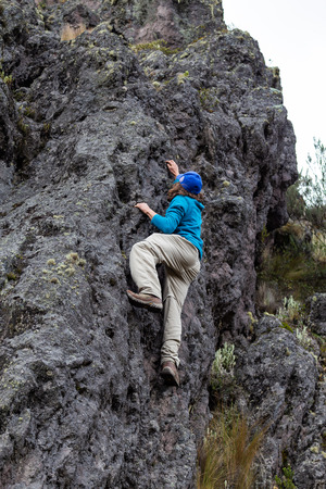 Man climbing a rock wall in freestyle