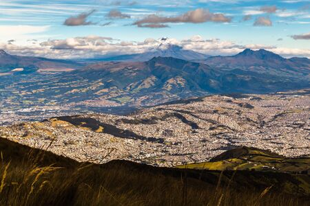 View of South Quito from the heights of Pichincha, with the volcanoes that surround it such as Cotopaxi, Pasochoa, Ruminiahui