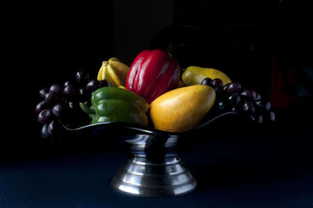 Bowl of fruit and vegetables with dark background