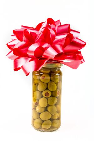 gag: Jar of  olives with bow isolated on white background isolated on white background