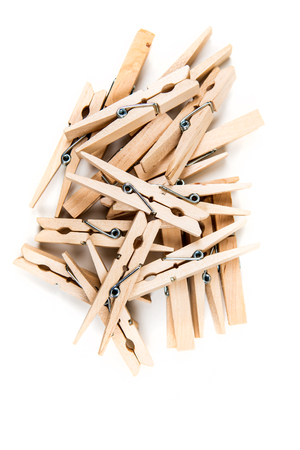 Pile of clothespins isolated on white background