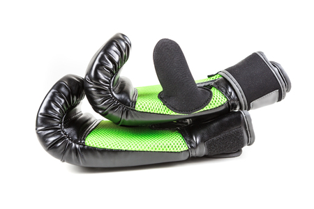 Green and black boxing gloves isolated on white background
