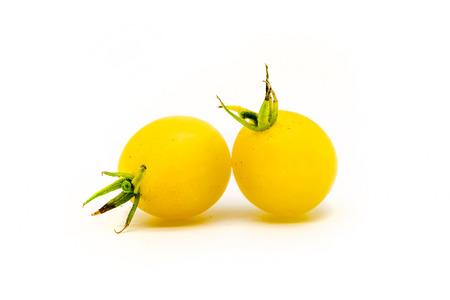 2 自家製チェリー トマト白で隔離 写真素材