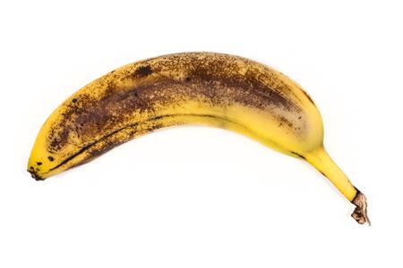 Old beaten banana isolated on white background