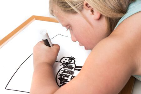erase: Young girl drawing on a dry erase board with a marker