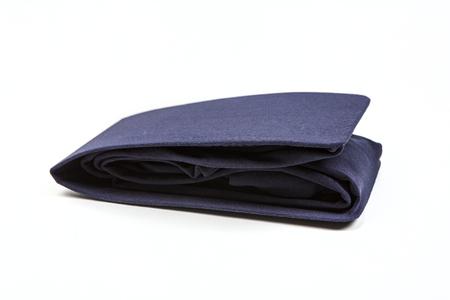 Folded blue stockings isolated on white background