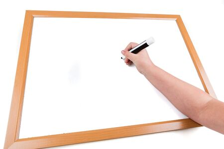 right handed: Child writing on a dry erase board with a marker