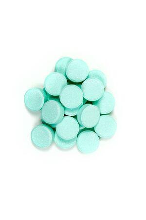 antacid: Minty antacid tablets isolated on white background