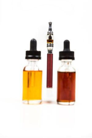 Assorted flavors of vape juice and an ecigarette isolated on white background