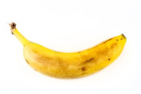 흰 배경에 고립 된 하나의 오래된 노란색 바나나