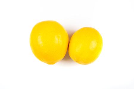 ascorbic acid: Two meyer lemons isolated on white background Stock Photo