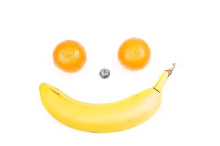 Happy fruit face with banana, blueberry and oranges isolated on white background 版權商用圖片