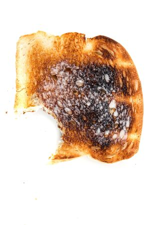 enriched: Burned whole grain toast isolated on white background