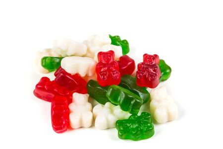 Red white and green gummy bears isolated on a white background